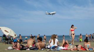 Locals and holiday makers sunbathe on southern coast of Cyprus on June 3 2012