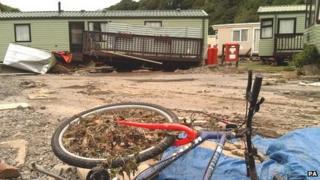 The aftermath of floods at the Riverside caravan park near Llandre, Aberystwyth