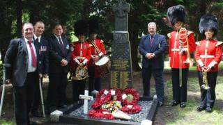 Members of the Welsh Guards Regimental Band with Falklands veterans in Wrexham