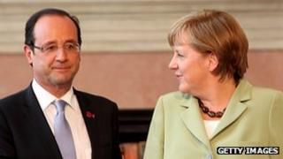 French President Francois Hollande (left) and German Chancellor Angela Merkel, 22 Jun 12
