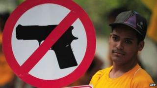 A file image of a man protesting against insecurity and violence in the Venezuelan capital, in Caracas, on 26 August 2010