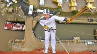 Torchbearer Alan Ellinson abseils down the side of the Royal Dock Tower in Grimsby