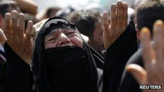 Shia pilgrim mourns at the Imam Moussa al-Kadhim shrine in Baghdad's Kadhimiya district June 16 2012