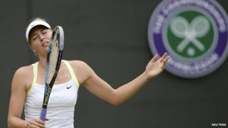 Sharapova reacts during tennis match