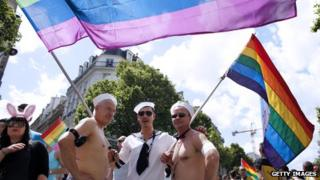 People parade during the 12th edition of the Gay Pride in Paris