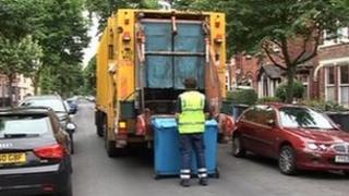 Man emptying bins in rubbish lorry