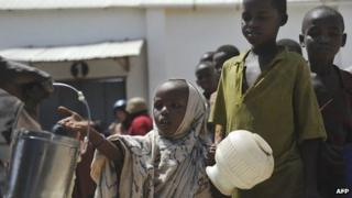 Displaced children queue for food rations in Somalia's capital, Mogadishu, in January 2012