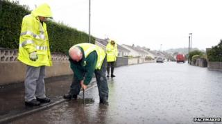 Workers check drains in Newcastle