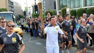 Lord Coe carries Olympic torch