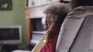 Elderly woman sitting alone