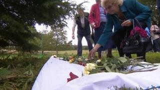 Relatives leave flowers at Saltram House