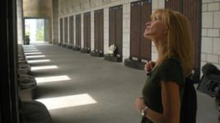 Jackie Bird looks at memorial plaques