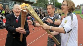 British athletics legend Sir Roger Bannister is one of today's torchbearers