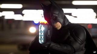 Christian Bale portrays Batman in a scene from The Dark Knight Rises