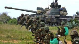 African Union peacekeepers take up positions during brief clashes with Islamist militants, June 2012