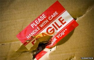 Damaged parcel with fragile sticker