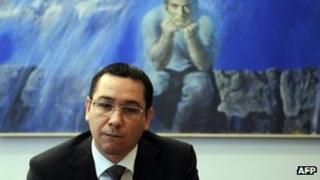 Victor Ponta looks at the Romanian Mission of the European Union, in Brussels, on July 12