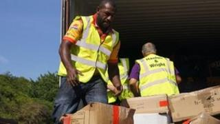 Menzie Yere loading donated kit