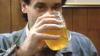 A man drinking cider