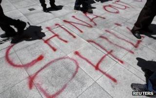 Graffiti by activists in front of the Chinese consulate in Manila, April 2012