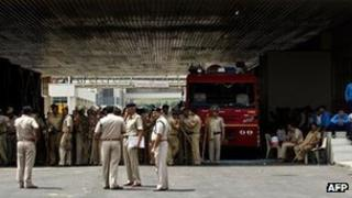 Indian policemen keep guard at the Maruti Suzuki Production Facility in Manesar, about 45 kms from New Delhi.