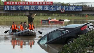 partly submerged car in river