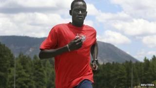 Guor Marial, 28, runs along a street in Flagstaff, Arizona, on 21 July 2012