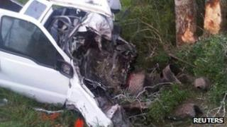 The wreckage of a pickup truck that crashed into a tree near Goliad, Texas 23 July 2012