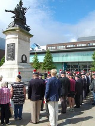 Veterans and members of the public during a two minutes silence at Old Eldon Square in protest at British army cuts