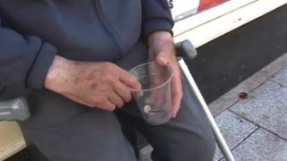 A beggar on a Cardiff street