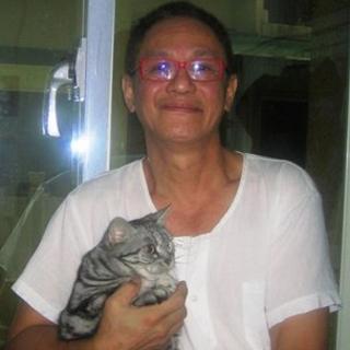 John Lin and his cat