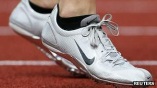An athlete wears a pair of Nike shoes