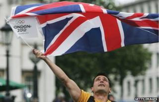 Person waving Union Jack