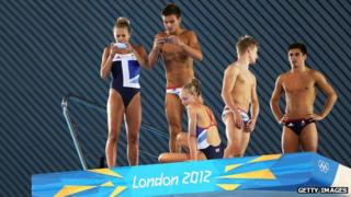 Team GB divers take photos from the diving board with their smartphones