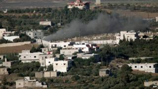 Smoke rising from the Syrian village of Jebata al-Khashab on 19 July as seen from Buqaata in the Israeli-occupied Golan Heights.