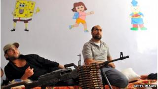 Fighters from the Syrian opposition rest at a former primary school in Aleppo