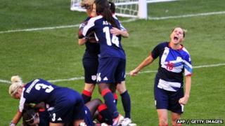 Britain's striker Kelly Smith (R) celebrates midfielder Jill Scott scoring the second goal against Cameroon