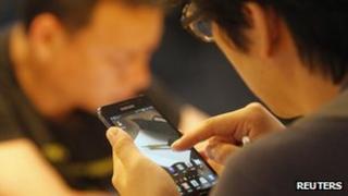 A South Korean using a smartphone