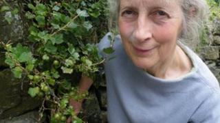 Fi Martynoga under a gooseberry bush