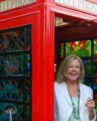 Hilary Beal in the telephone box