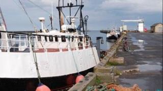 Fishing boats docked on Amble's quayside