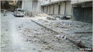 Damaged shops and rubble in Aleppo, Syria (1 August 2012)