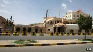 Concrete barriers surround the Italian embassy a day after an Italian officer was kidnapped in Sanaa, 30 July 2012