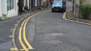 Yellow lines and pavement markings on Well Street, Ruthin