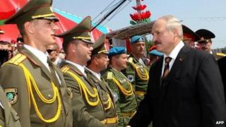 Belarus's President Alexander Lukashenko meets officers during a military parade in Minsk on 3 July