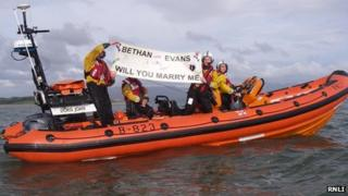 The crew circled the lifeboat before unfurling the banner near the pier