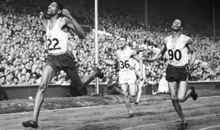 Arthur Wint equals the world record as he wins Olympic gold in the 400 metres event at Wembley Stadium in London, August 1948. Fellow Jamaican Herbert McKenley, right, finished second