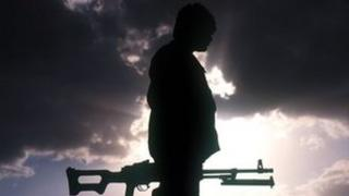 Silhouette of a Kurdish fighter
