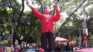 An inflatable figure of Hugo Chavez outside a polling booth in Caracas, Venezuela