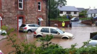 Flooded cars in Galston